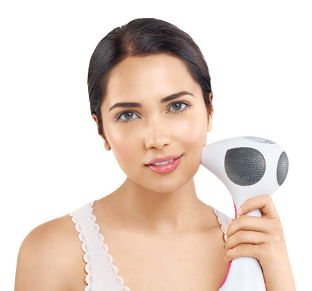 Woman treating her face with the Tria Beauty Hair Removal Laser 4X
